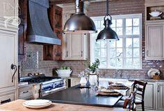 Kitchen with white cabinets and subway tile backsplash