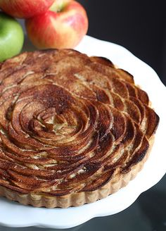 """Apple Flower Frangipane Tart _ This is a certified """"Fancy"""" apple tart made with a Pate Sucrée (sweet crust), Frangipane (almond pastry cream filling), & thin apple slices layered to create a """"flower"""" effect!"""