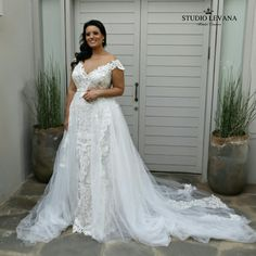 Curvy wedding dress just has to be with a stunning train!