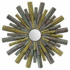 Multicolor wood wall mirror with a starburst motif.  Product: Wall mirrorConstruction Material: Wood and mirrored glassColor: Green, blue and grayDimensions: 37.5 Diameter x 5 D