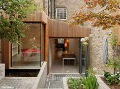 Extension en bois maison ouverte sur le jardin