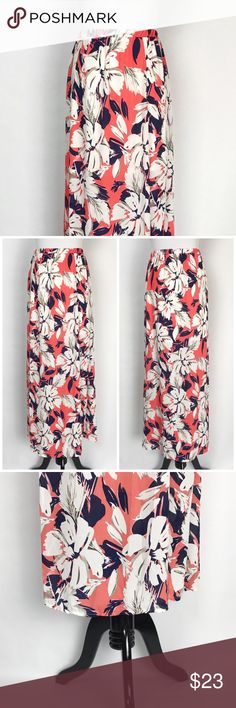 "Hawaiian Floral Maxi Skirt Beautiful hawaiian floral print orange, navy blue and white maxi skirt. Features 2 front slits and is lined to mid thigh. 100% Polyester. Made is the USA. Laying Flat: 41"" Long x 15"" Waist. Measurements are approximate. Boutique Skirts Maxi"