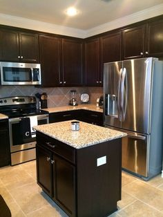 Dark cabinets white subway tile backsplash and revere for Chocolate kitchen cabinets with stainless steel appliances