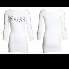 JUST REDUCED! Sinful L/S Lightweight Dress This beauty is great as a dress, and can even be worn as a tunic! It has a wide neckline that is ribbed, as well as the sleeve & bottom hemlines. The logo is scrolled across the front, with rhinestones, and has fleur-de-lis down each arm. The sleeves have corset-style ties too! Step out in style with this awesome dress and some tall boots! Sinful Dresses Long Sleeve