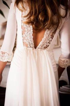 Deep lacey V back on a long sleeve white dress