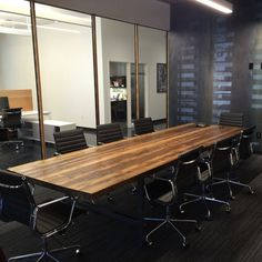 Conference room table in thick 2.5 top and reclaimed wood and steel legs in your choice of color, size and finish