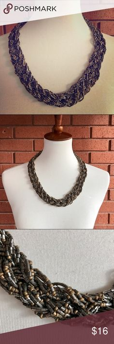 Braided Beaded Statement Necklace Silver braided beaded statement necklace in excellent condition. Woven clasp closure. Super cute and unique! Jewelry Necklaces