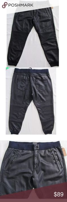 TRUE RELIGION COATED LEATHER LIKE MOTO JOGGERS 100% authentic TRUE RELIGION Coated Moto Joggers  $229 retail price brand new w tags!!  Transform your activewear with TRUE RELIGION's one-of-a-kind coated moto sweatpants. Men's sweatpant 100% cotton  A leather-look coated finish and seamed knee panels pump up the moto style on sleek cotton-blend pants finished with edgy hardware and signature embroidery on the back pocket. Zip fly with button closure. Front zip pockets; back patch pocket…