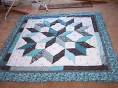 Fun quilt to make. Pattern is called Carpenters Star.