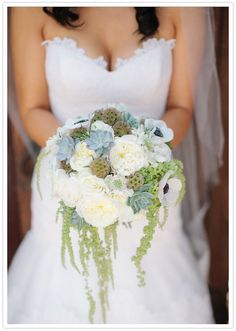 white and green succulent bouquet - with a navy blue bridesmaid dress!!!