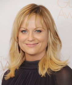 Amy Poehler (with new bangs!) at the Writer's Guild Awards. Click for all the looks!