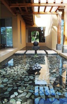 """This is what I have in mind for the pond. Maybe only half as wide, on both sides of both breezeways. Floating stepping stones (shown in picture) leading into the entryway. The effect will be like the entryway and breezeways are over water. The water can be shallow like this with a few small colorful fish, or 24"""" deep for a koi pond."""