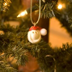 Nothing says Christmas like a new ornament to add to your collection! Now you can trim your tree with our our limited edition Ornament Seed. It is also the perfect gift for family and friends. Each ornament comes with a story card. Share the spirit, share the Smiles! All seeds handmade, fired & glazed in the USA. $5.00
