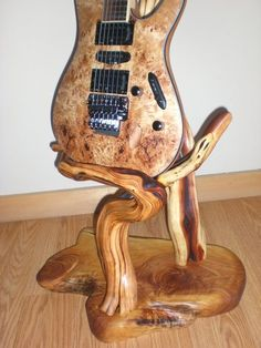 Manzanita Guitar Stand. I think that I would totally use this if it was in my price range...