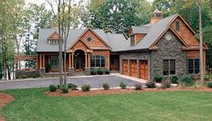 House Plans   Designer Favorites   Living Concepts House Plans    - love the cedar shake, the stone, the details.  too much square footage.  Downstairs stonework is pretty cool!