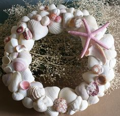 Seashell wreath,  pink and white, beach wreath, summer, coastal, shabby chic, cottage chic, beach decor, princess room, wall decor, wall art. $59.99, via Etsy.