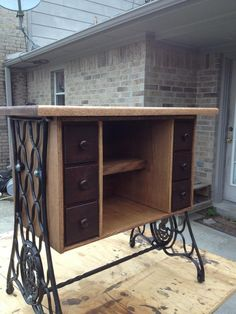 Last project I finished. Old sewing machine drawers and legs repurposed.