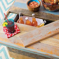 Create a cool place for a cold one! A faux-reclaimed cedar beverage table is the center of attention in the lounge area. Its hinged design and removable plank allow easy access to the 5-gallon drink bucket inside. #fall #football #tailgate #backyard #lowes
