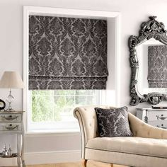 Fabricated with luxurious charcoal damask designs, this patterned roman blind features an elegant subtle sheen and is available in a range of sizes to fit your window dimensions.