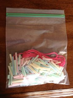 Busy Bag Idea: straw and string- make a straw necklace (finished).  Tons of other ideas.  Just follow the link.