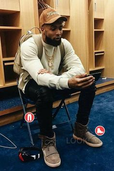 Odell Beckham Jr. wearing the new Yeezy Boost 750 sneakers in brown. Click through to see more outfit details.