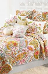 Nordstrom has really cute quilts and matching pillows, that are less pricey than Pottery Barn.
