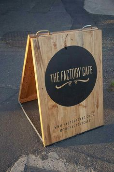 Signage- sandwich board DIY. Plywood, hinges, handles, cross stabilizers. Exterior paint with weather protected gloss top coat.