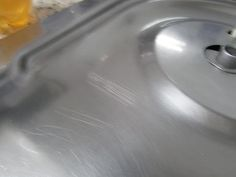 Como Remover Arranhões de Inox 1 pedaço de lixa d'água bem fina (pode ser a de…