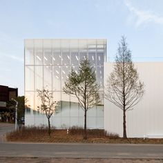 White Block Gallery by SsD features fritted glass designed to evoke morning fog