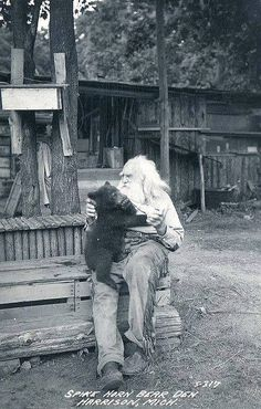 A real-life Grizzly Adams! This is a photo of a man named Spikehorn Meyers who ran a bear refuge in Michigan in the 1930's. He's considered one of the state's most colorful characters and was known as the Bear Whisperer.     #historicalphoto #historicalpics #vintage #retro #weird #old #weird&old #nightvisiongoogles