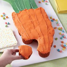 Looks like a cake, but this giant carrot shape is made up of individual cupcakes. Use Candy Melts® candy to make the leaves that add a realistic finishing touch!  This pull-apart carrot cupcake cake is the perfect centerpiece for your Easter sweet table, plus it is easy to serve--guests just grab a cupcake and go!