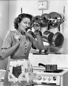 Mother In the kitchen, 1950s , wearing her dress and jewelry - just like Mrs. Cleaver