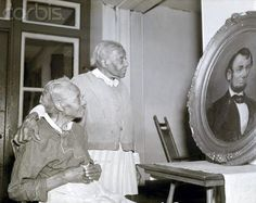 Jennie Jacobs (l), 96, and Phyllis Pollitt, 99, prepare to celebrate the birthday of Abraham Lincoln at an old folks' home in Philadelphia.Both are former slaves. Mrs. Pollitt is a native of North Carolina, where she was born in slavery; Mrs. Jacobs was freed from the state of Delaware. Photo taken February 10th 1940. Photo Credit: Corbis Images.