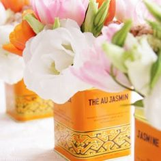 Use antique, colorful tins for flowers.  One of my favorite tricks.