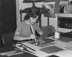 Sharon Conway bookbinding in the National Archives, one of the employees being supervised by Mrs. Blanca Tome of Document Preservation.
