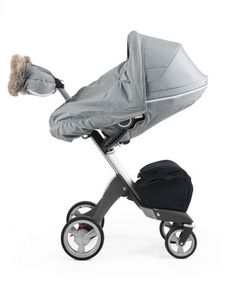 Stokke Stroller Winter Kit is designed as the perfect outerwear for your stroller.  The insulated fabric together with the additional storm cover safeguards your child from harsh winter winds.  Features genuine sheepskin rims.  Your child will feel snug and stay protected from low temperatures and biting wind while enjoying the wonders of winter.