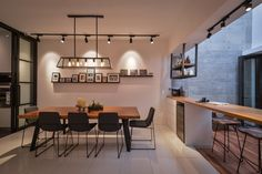 Contemporary dining area achieved with beautifully selected furniture, lighting and decor.