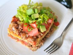 This layered taco casserole is comfort food without a helping of regret. There are still layers of everything that make taco casserole great: tortillas, se