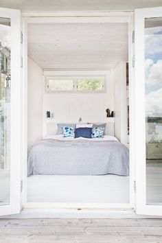 Tiny Bedroom in Swedish Cottage I Remodelista - Table of Contents: Scandinavian Blues by Remodelista Team Issue 23 · Scandinavian Blues · June 8, 2015