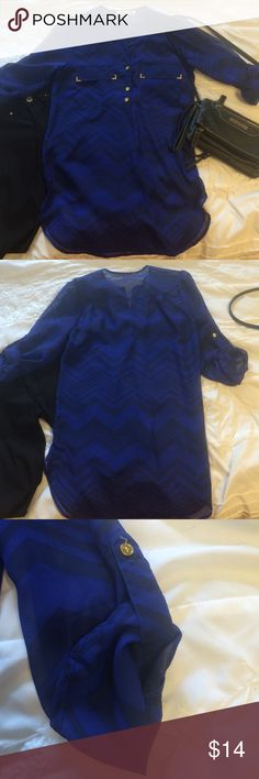 Chevron sheer polyester top This shirt is a bright blue color with navy chevron stripes. The pockets have gold accents and the buttons are gold. Also, their is a button on each of the sleeves so you can roll them up. Tops Tunics