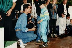 After such a special win in Sepang. a look at 7 year old Sebastian Vettel, getting a trophy from his hero, Michael Schumacher.