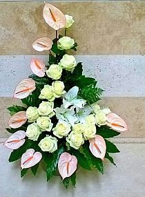 Awesome flower arrangement with roses and anthuriams. Looks like seashells from a distance. Tropical Flower Arrangements, Church Flower Arrangements, Orchid Arrangements, Beautiful Flower Arrangements, Altar Flowers, Church Flowers, Funeral Flowers, Exotic Flowers, Tropical Flowers