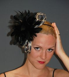 Black feather fascinator with animal print sinamay loops