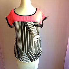 "NWOT Pink and Black Top OFFERS WELCOME. PLEASE USE THE OFFER BUTTON. I do not negotiate price in the comments. Great abstract print color block top. Material is sheer, unlined. High-low -- length is 24"" in back and 21"" in front. 18"" across at bustline. No stretch. 100% polyester. Fly-away detail in back. Mine Tops Blouses"