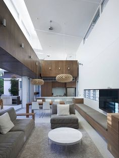 Australian studio Bark Design Architects has designed the Sunshine Beach House.  This contemporary two story vacation home is located in Queensland, Australia. Love the skillion ceiling? And pendant lights