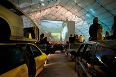 Brooklyn-based artists Jeff Stark and Todd Chandler are the ones behind Empire Drive-In, a drive-in movie theater complete with viewing seats repurposed fr Drive In Cinema, Cinema Experience, Drive In Movie Theater, Movie Drive, Junkyard Cars, Shipping Containers For Sale, Outdoor Cinema, Salvage Cars, Travel And Leisure