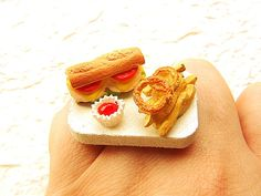 When you don't want to cook....grab some take out!    It is on a silver tone adjustable band that will fit most ring sizes. It measures about 3 cm wide.    SouZouCreations' products are made with attention to detail, creativity and long lasting dependability.