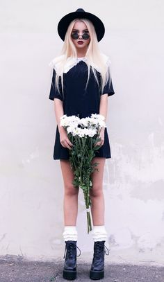 Black dress and black boots with bunched up white socks - http://ninjacosmico.com/11-ways-wear-black-dresses-summer/