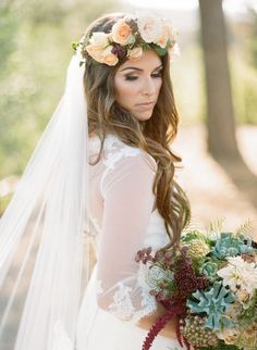 Gorgeous bohemian flower crown wedding hairstyle with beach waves; Featured Photographer: Acres of Hope, Featured Event Planner: Très Chic Affairs