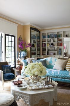 Windsor Smith's Brentwood home, ready for a dinner party - antique silver bowl, Berbere Imports table, sofa from her collection is covered in an antique Moroccan bedspread
